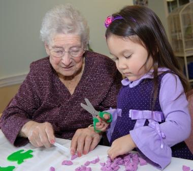 Older woman and young girl doing crafts